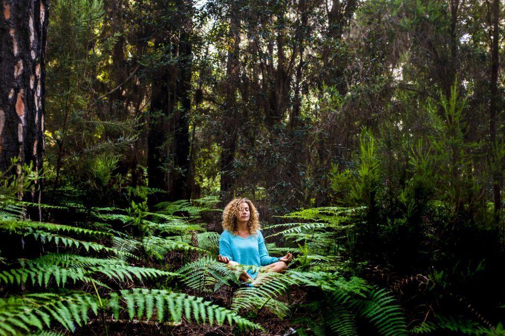 Beautiful adult lady do mindfulness exercises and yoga