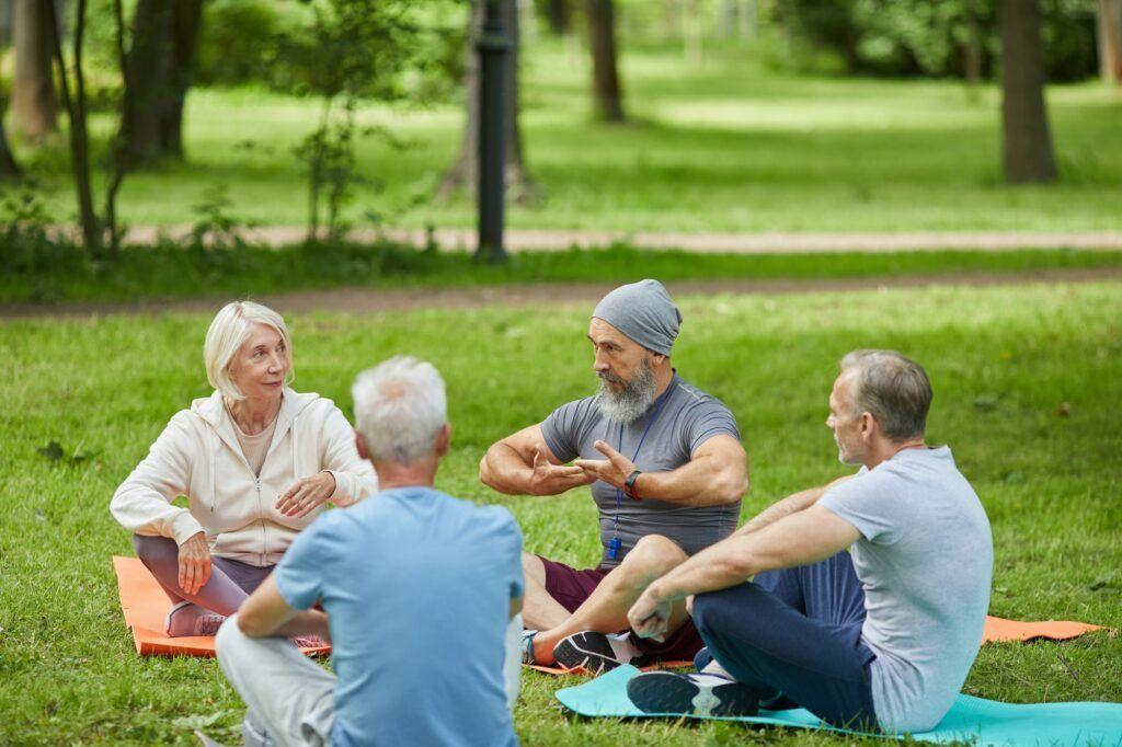 Seniors Practicing Yoga In Park